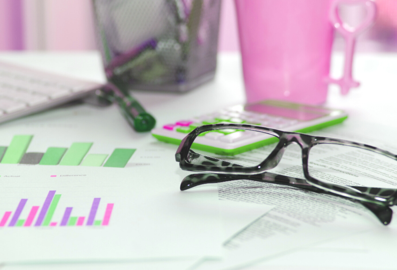 Business Graphs, Glasses and pens